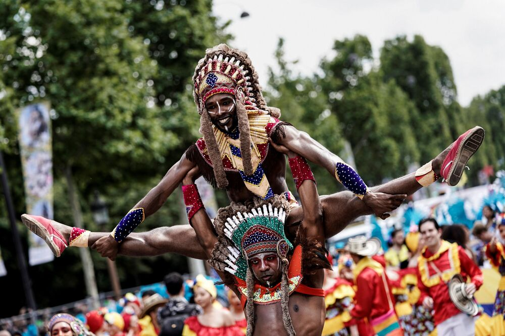 Men taking part in the Tropical Carnival on July, 7 2019 in Paris.