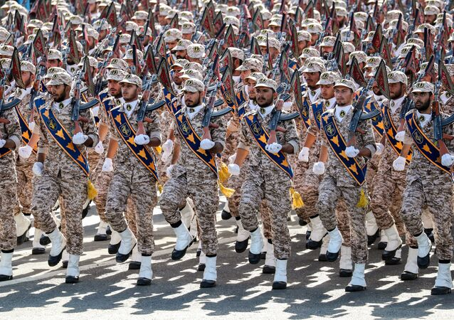 Members of Iran's Revolutionary Guards Corps (IRGC) march during the annual military parade marking the anniversary of the outbreak of the devastating 1980-1988 war with Saddam Hussein's Iraq, in the capital Tehran on September 22, 2018
