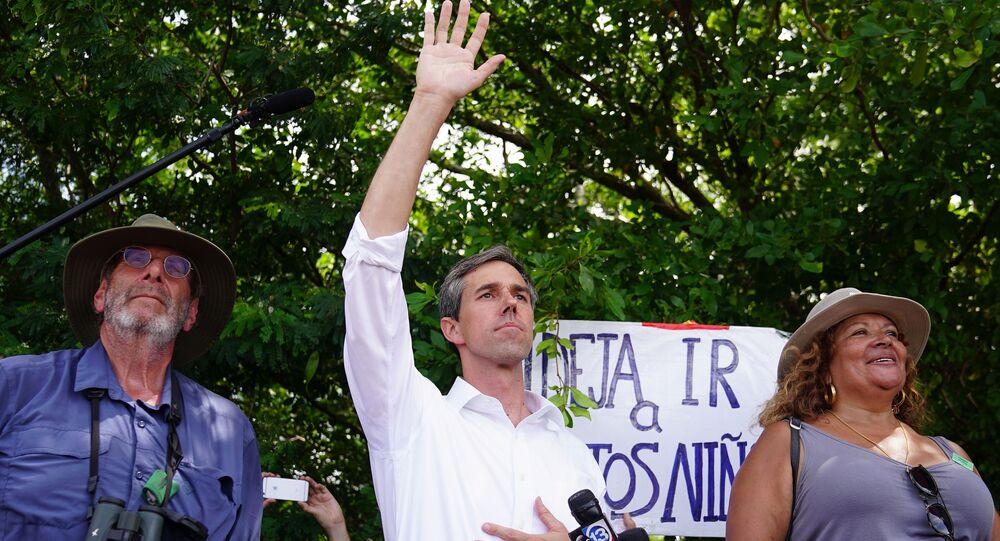 Democratic presidential candidate Beto O'Rourke waves at a detention facility for incarcerated youths near Miami in Homestead, Florida