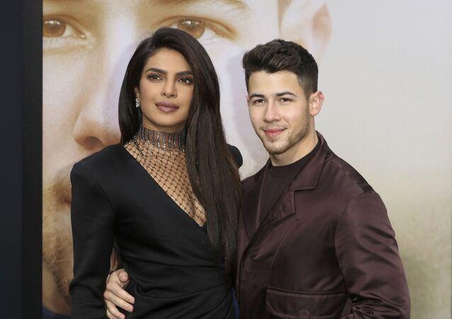 Priyanka Chopra, left, and Nick Jonas attend the World Premiere of Chasing Happiness, on Monday, June 3, 2019, in Los Angeles