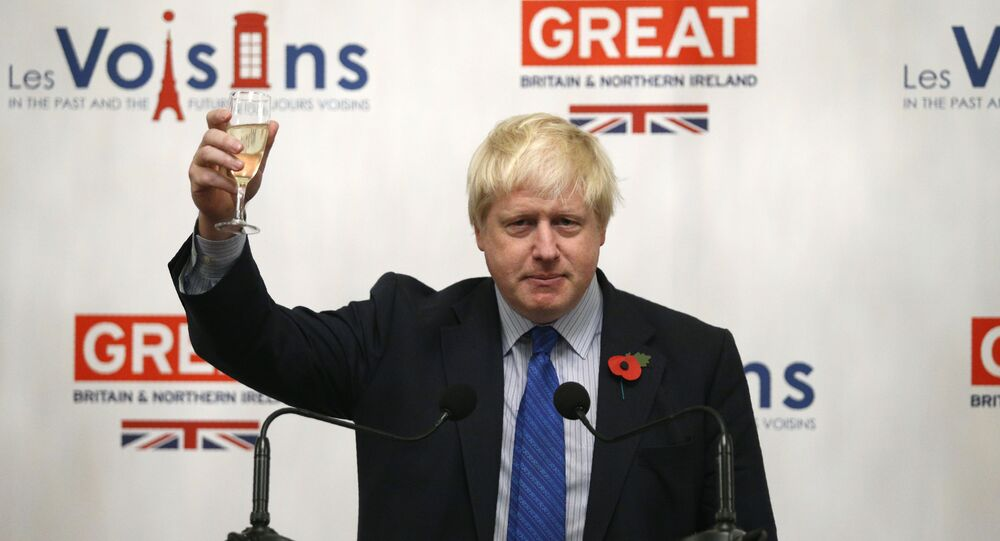 British Foreign secretary Boris Johnson drinks a toast at the UK embassy in Paris on October 27, 2017, during his European tour on Brexit