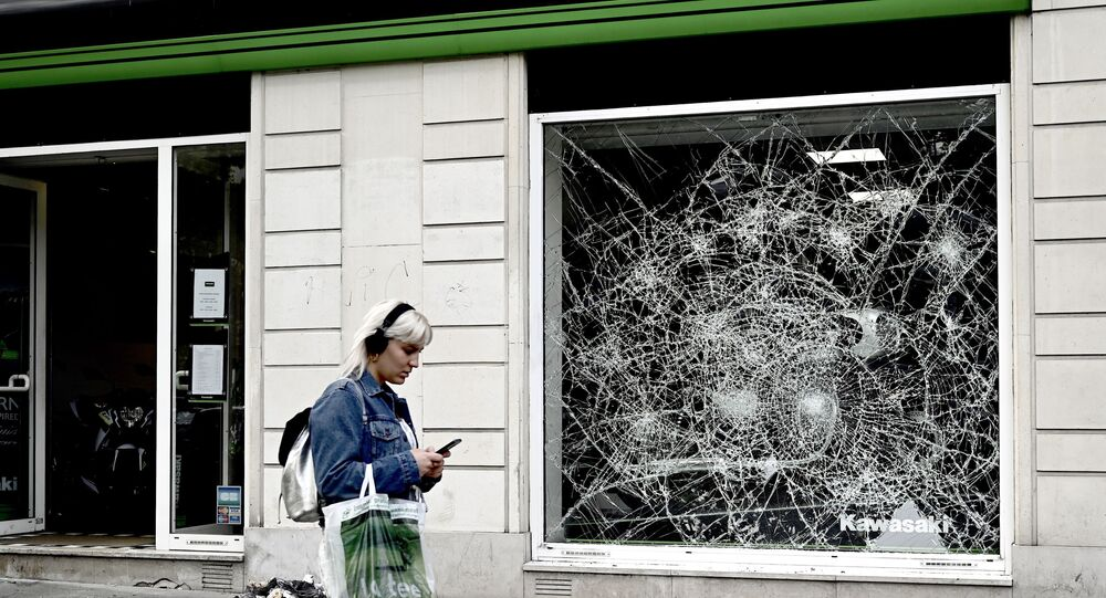 This picture taken on July 12, 2019, shows a broken window on the Avenue de la Grande Armee, near the Arc de Triomphe in Paris where Algerian supporters celebrated the victory of their team during the 2019 Africa Cup of Nations (CAN) quarter final football match between Ivory Coast and Algeria, on July 11, 2019
