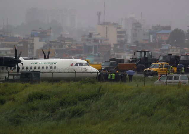 A Yeti Airlines plane lies near the runway after it skidded off while landing at Tribhuvan International Airport in Kathmandu, Nepal July 12, 2019