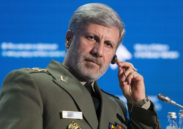 Iranian Defense Minister Amir Hatami listens during the Conference on International Security in Moscow, Russia, Wednesday, April 4, 2018