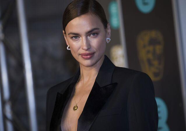 Irina Shayk poses for photographers upon arrival at the BAFTA awards in London, Sunday, Feb. 10, 2019