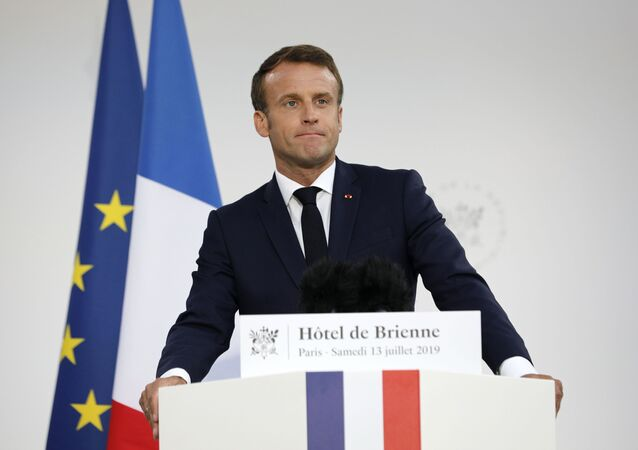 French President Emmanuel Macron delivers a speech at the residence of French Defense Ministry on the eve of Bastille Day, on July 13, 2019, in Paris.