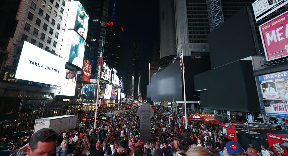 Screens in Times Square are black during a power outage, Saturday, July 13, 2019, in New York. Authorities were scrambling to restore electricity to Manhattan following a power outage that knocked out Times Square's towering electronic screens and darkened marquees in the theater district and left businesses without electricity, elevators stuck and subway cars stalled. (AP Photo/Michael Owens)