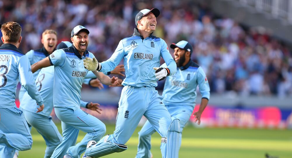 England's Jos Buttler (C) celebrates with teammates after they win the super over to win the 2019 Cricket World Cup final between England and New Zealand at Lord's Cricket Ground in London on July 14, 2019