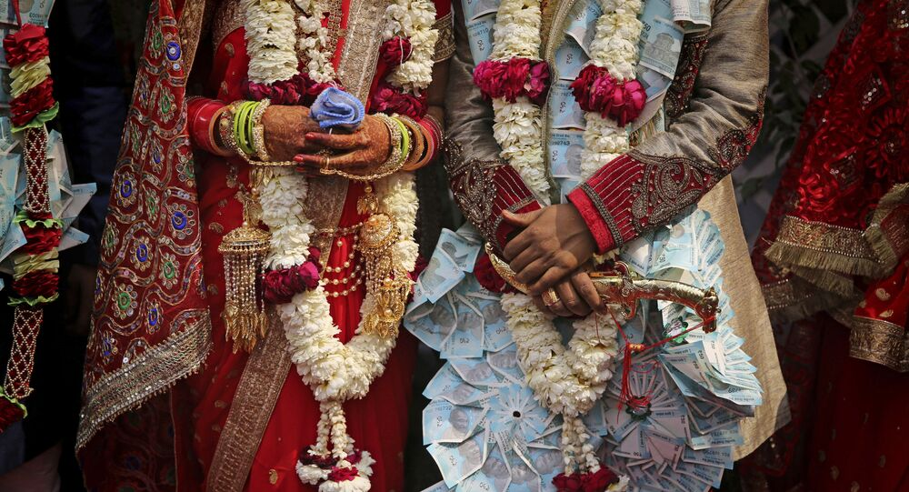 A newly wed Indian couple poses for photographs in New Delhi, India (File)