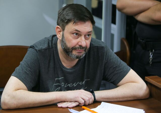 RIA Novosti Ukraine news portal head Kirill Vyshinsky reacts in the court room in Kiev, Ukraine