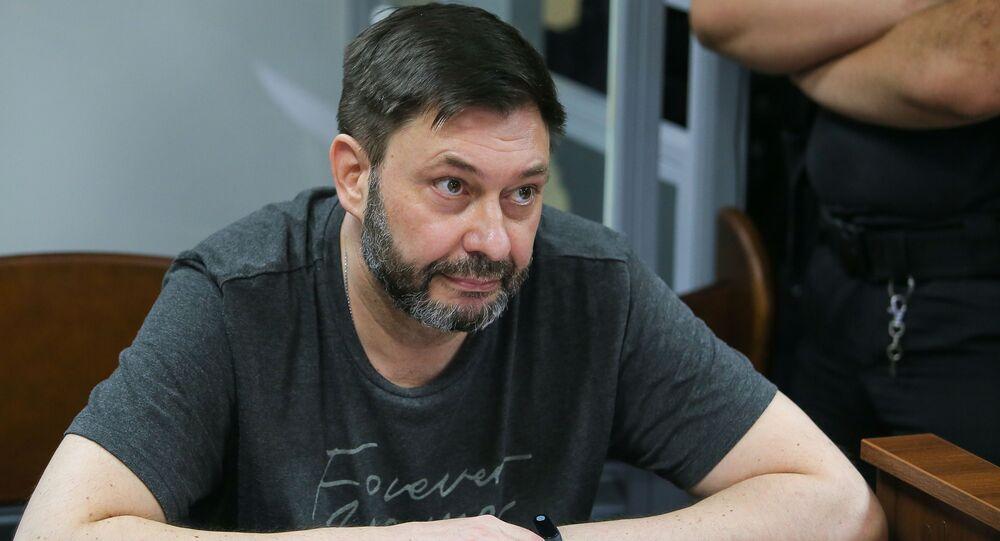 RIA Novosti Ukraine news portal head Kirill Vyshinsky reacts in the court room in Kiev, Ukraine