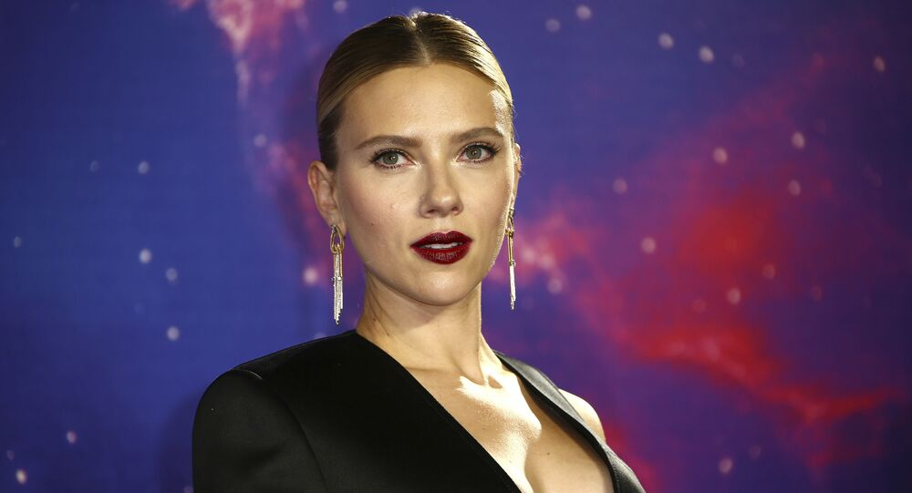 Actress Scarlett Johansson poses for photographers upon arrival at the 'Avengers Endgame' fan event in London, Wednesday, April 10, 2019