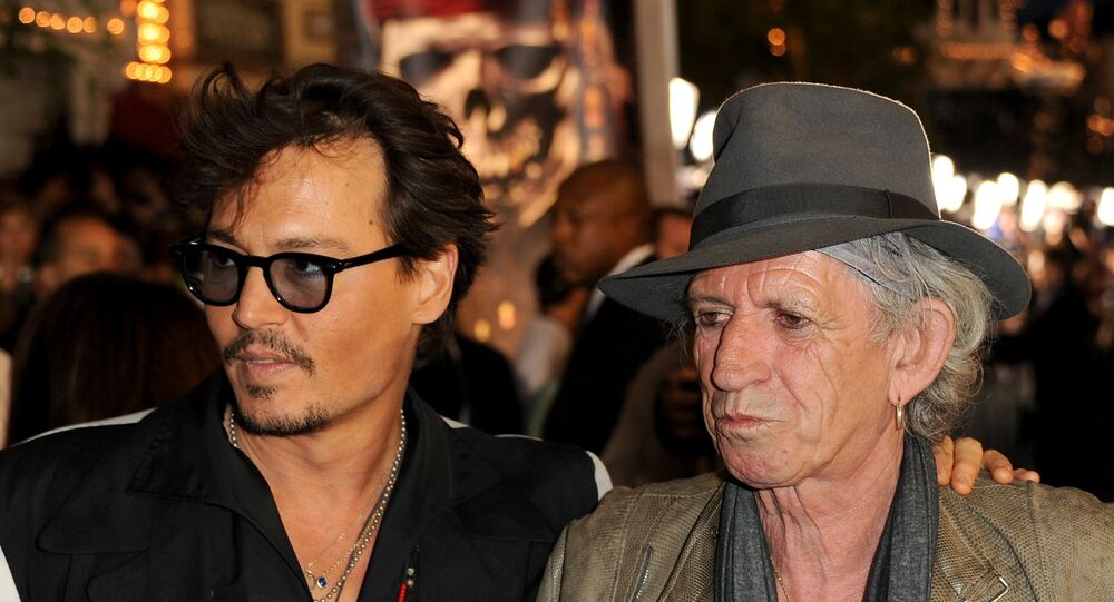Actor Johnny Depp (L) and actor/musician Keith Richards arrive at premiere of Walt Disney Pictures' Pirates of the Caribbean: On Stranger Tides held at Disneyland on May 7, 2011