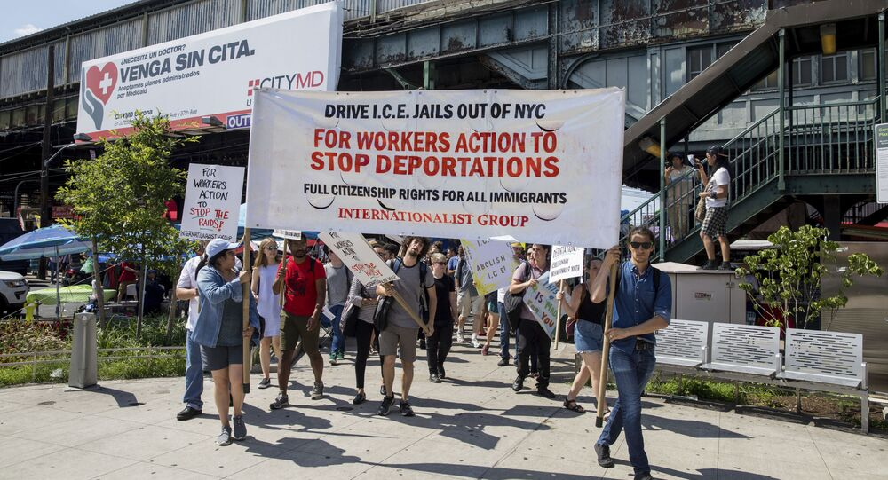 Hundreds of people arrive in Corona Plaza in the Queens borough of New York at the end of a march in opposition to the Trump administration's plans to continue with raids to catch immigrants in the country illegally, Sunday, July 14, 2019.