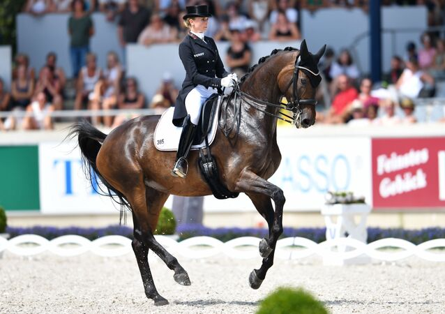 German dressage rider Jessica von Bredow-Werndl on her horse Dalera competes during the World Equestrian Festival CHIO in Aachen Germany on July 21, 2018