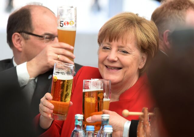 German Chancellor Angela Merkel toasts the 500th anniversary of the German beer purity requirements, in Ingolstadt, southern Germany, on April 22, 2016