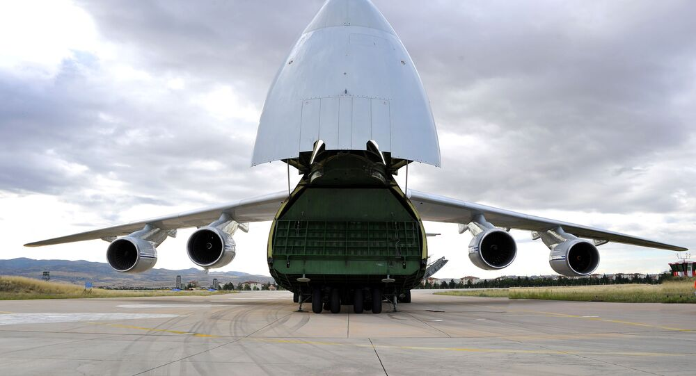 The first parts of a Russian S-400 missile defence system are unloaded from a Russian plane at Murted Airport, known as Akinci Air Base, near Ankara, Turkey, 12 July 2019
