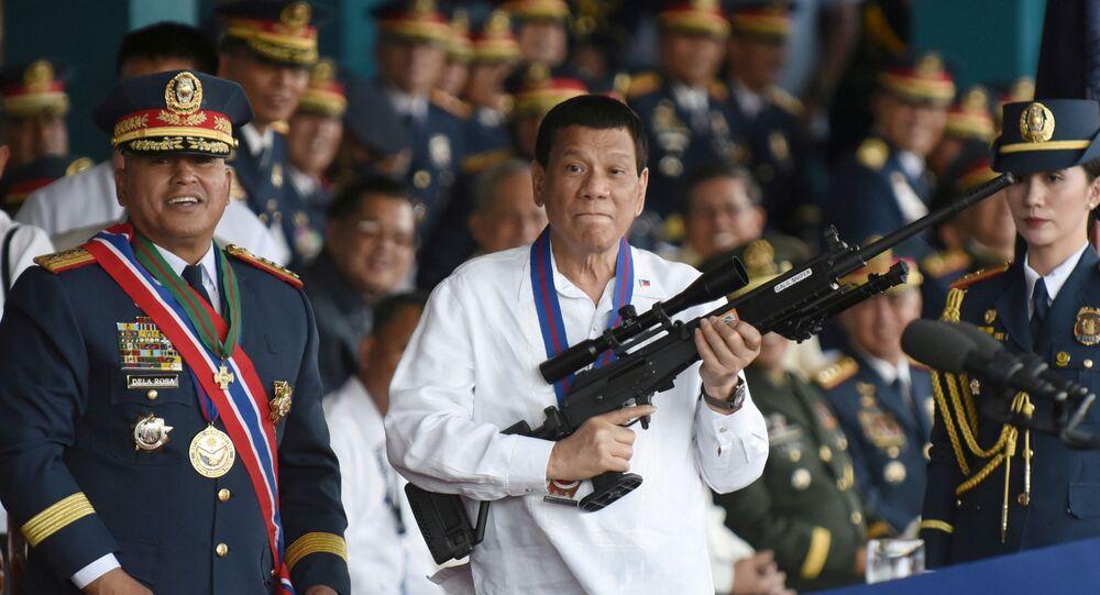 Philippine President Rodrigo Duterte holds a Galil sniper rifle next to outgoing Philippine National Police Chief Ronald Bato Dela Rosa during the National Police chief handover ceremony in Camp Crame, Quezon City, metro Manila, Philippines, April 19, 2018