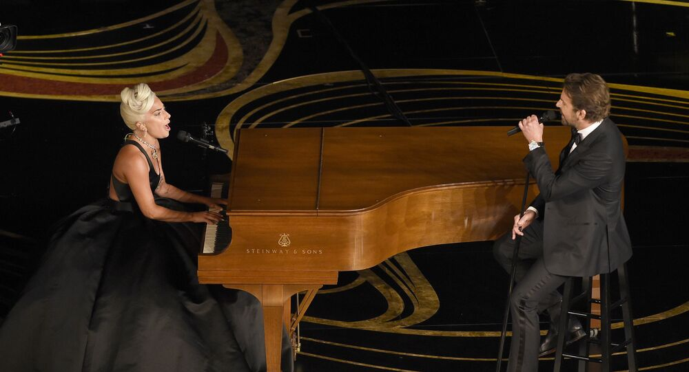 Lady Gaga, left, and Bradley Cooper perform Shallow from A Star is Born at the Oscars on Sunday, Feb. 24, 2019, at the Dolby Theatre in Los Angeles