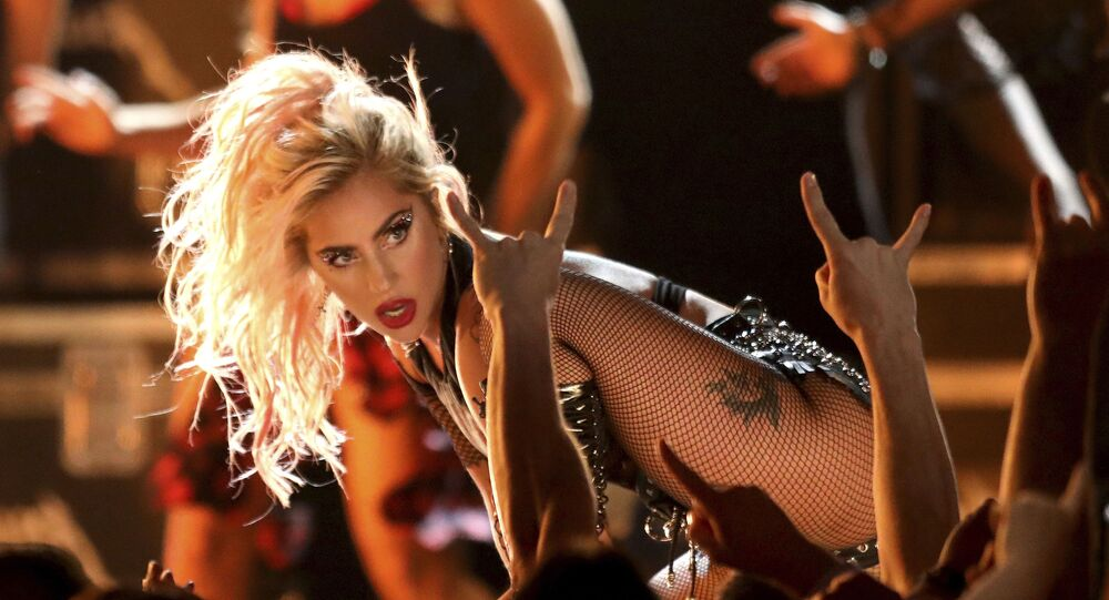 In this Feb. 12, 2017 file photo, Lady Gaga performs Moth Into Flame at the 59th annual Grammy Awards in Los Angeles.