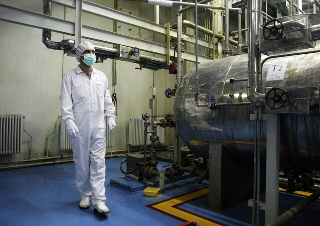 In this Saturday, Feb. 3, 2007 photo, an Iranian technician walks through the Uranium Conversion Facility just outside the city of Isfahan 255 miles (410 kilometers) south of the capital Tehran, Iran