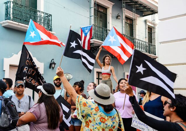 Demonstrators chant and wave Puerto Rican flags during the fourth day of protest calling for the resignation of Governor Ricardo Rossello in San Juan, Puerto Rico July 16, 2019.