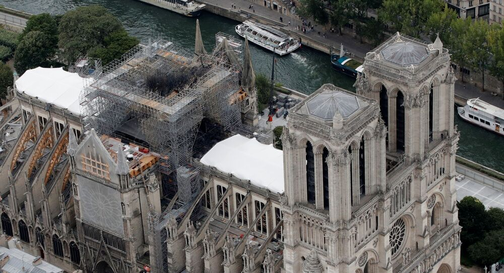 An aerial view shows the damaged roof of Notre-Dame de Paris during restoration work, three months after a fire that devastated the cathedral in Paris