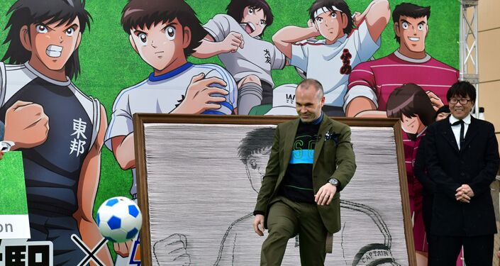 Spanish footballer Andres Iniesta, who plays for Vissel Kobe, at an event with the author of the famous anime Captain Tsubasa