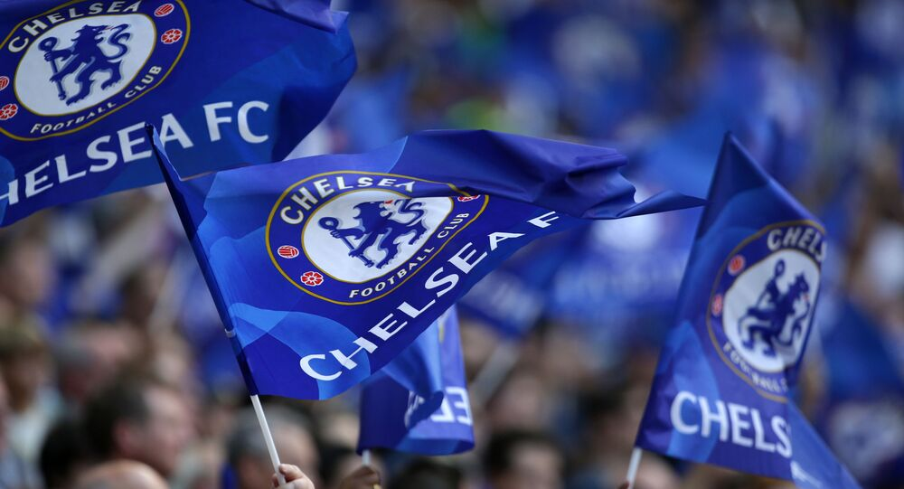 Cheslea supporters wave flags in the crowd ahead of the English FA Community Shield football match between Arsenal and Chelsea at Wembley Stadium