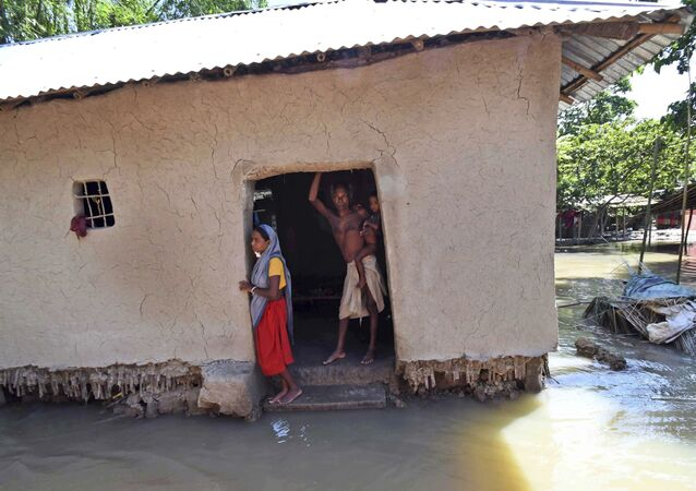 Villagers stand inside their house destroyed by floodwaters at Katihar district, in the eastern Indian state of Bihar (File)