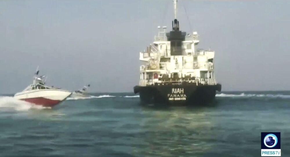This undated photo provided by Iranian state television's English-language service, Press TV, shows the Panamanian-flagged oil tanker MT Riah surrounded by Iranian Revolutionary Guard vessels.