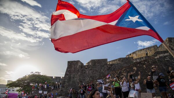 Demonstrators march against governor Ricardo Rosello, in San Juan, Puerto Rico, Wednesday, July 17, 2019. Protesters are demanding Rossello step down for his involvement in a private chat in which he used profanities to describe an ex-New York City councilwoman and a federal control board overseeing the island's finance. - Sputnik International