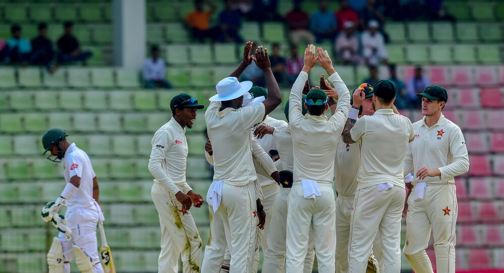 Zimbabwe's team celebrates the dismissal of the Bangladesh's Liton Das (L) during the fourth day of the first Test cricket match between Bangladesh and Zimbabwe in Sylhet on November 6, 2018
