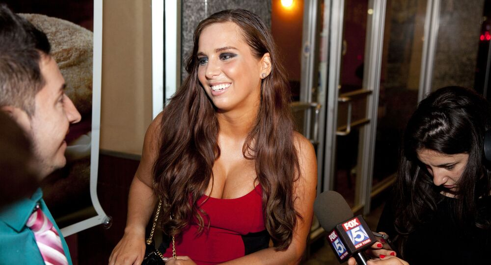 Sydney Leathers, who engaged in online sex chats with Democratic mayoral hopeful Anthony Weiner last summer, tries to enter his election gathering place at Connolly's Pub in midtown Tuesday, September 10, 2013 in New York