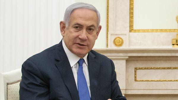 Israeli Prime Minister Benjamin Netanyahu gestures while speaking to Russian President Vladimir Putin during their meeting in the Kremlin in Moscow, Russia, Thursday, April 4, 2019 - Sputnik International