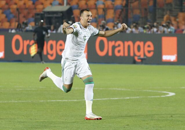Algeria's Djamel Eddine celebrates a goal during the African Cup of Nations final soccer match between Algeria and Senegal