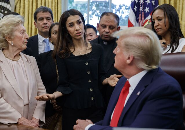 President Donald Trump listens to Nobel Peace Prize winner Nadia Murad, a Yazidi from Iraq, center, as he meets with survivors of religious persecution in the Oval Office of the White House on Wednesday, July 17, 2019, in Washington.