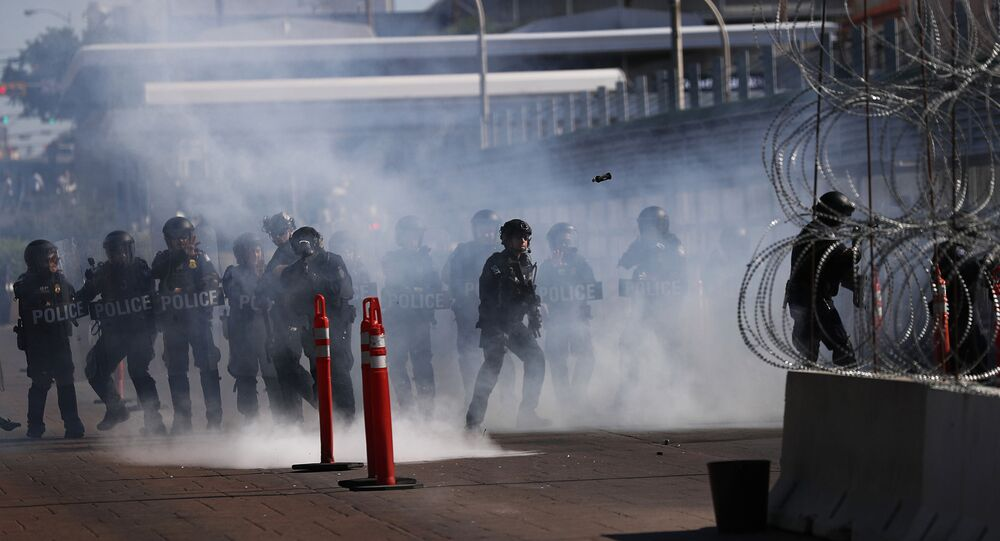 U.S. Customs and Border Protection police conduct a drill using tear gas on International Bridge 1 Las Americas, which connects Laredo, Texas in the U.S. with Nuevo Laredo, Mexico