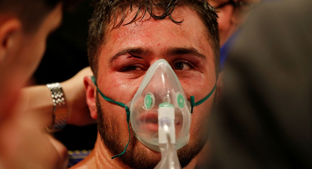 Boxing - Dave Allen v David Price - 02 Arena, London, Britain - July 20, 2019   Dave Allen receives medical attention after losing the fight   Action Images via Reuters/Andrew Couldridge