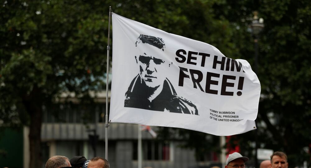Supporters of right-wing activist Stephen Yaxley-Lennon, who goes by the name Tommy Robinson, protest in London on 11 July 2019