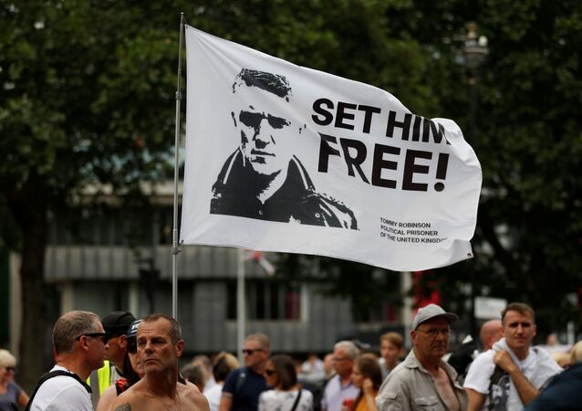 Supporters of right-wing activist Stephen Yaxley-Lennon, who goes by the name Tommy Robinson, protest in London, Britain, July 11, 2019.