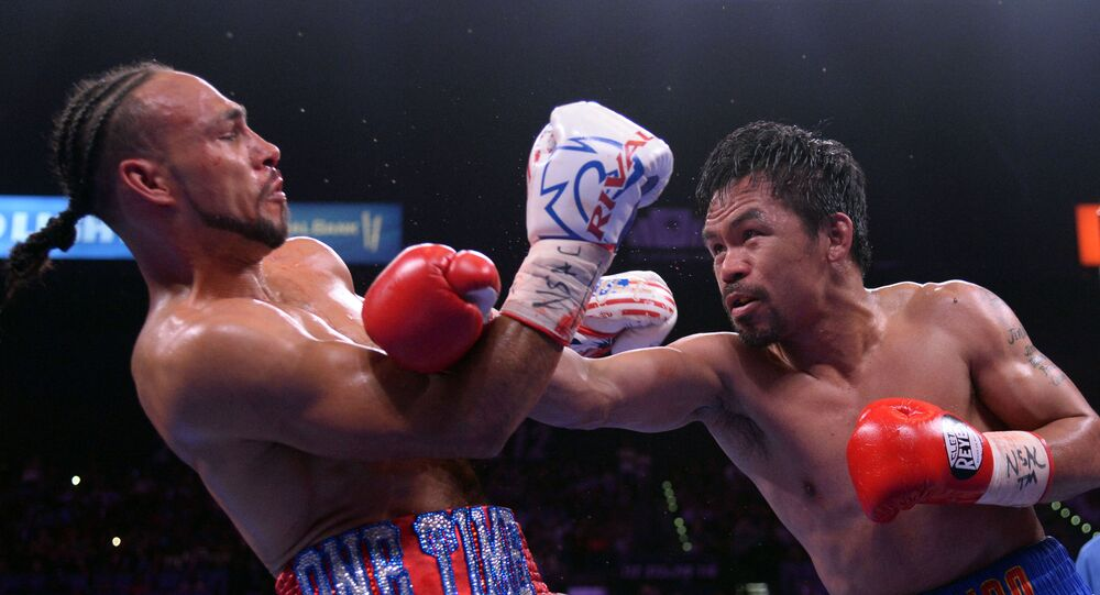 20 July 2019; Las Vegas, NV, USA; Manny Pacquiao (white trunks) and Keith Thurman (red/white/blue trunks) box during their WBA welterweight championship bout at MGM Grand Garden Arena. Pacquiao won via a split decision. Mandatory Credit: Joe Camporeale-USA TODAY Sports