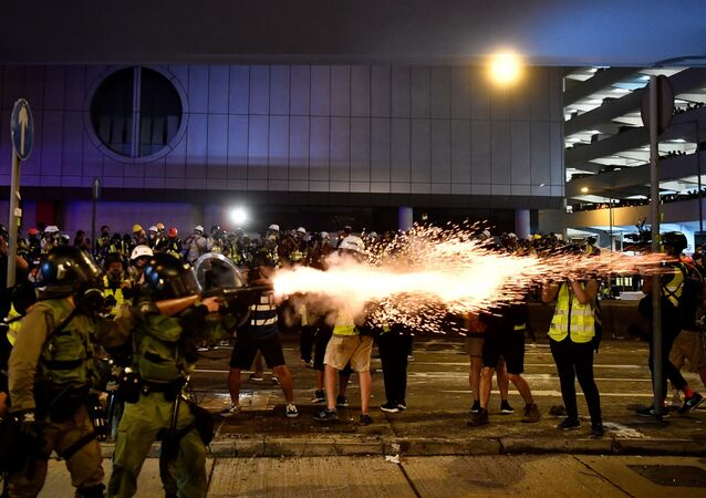 A policeman fires tear gas at protesters to disperse them after a march against a controversial extradition bill in Hong Kong on July 21, 2019.