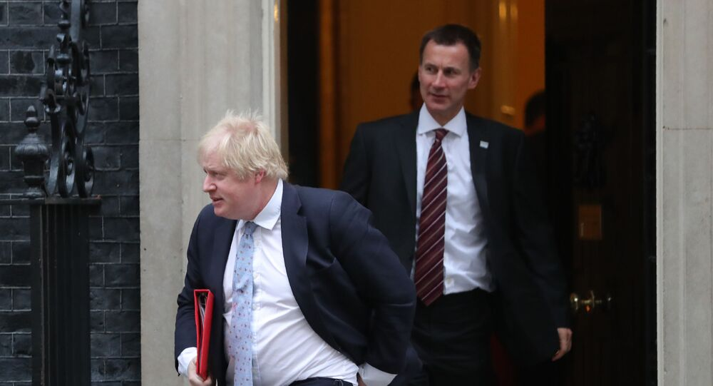 Britain's Foreign Secretary Boris Johnson (L) and Britain's Secretary for Health and Social Care Jeremy Hunt leave 10 Downing street in central London for the first cabinet meeting of the new year following a reshuffle on 9 January 2018
