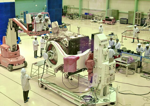 (FILES) In this file photo taken on June 12, 2019, Indian Space Research Organisation (ISRO) scientists work on the orbiter vehicle of 'Chandrayaan-2'