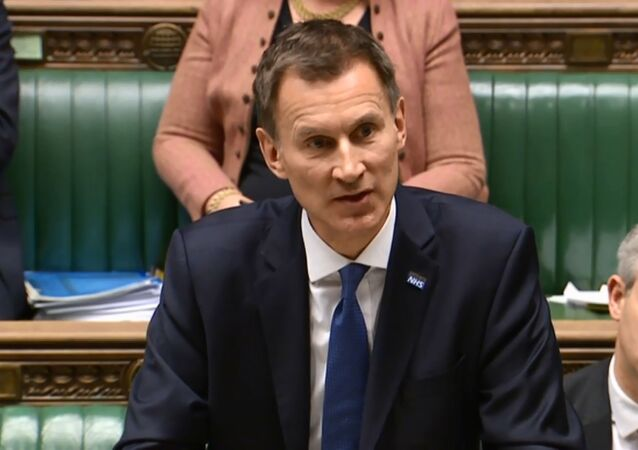 A video grab from footage broadcast by the UK Parliament's Parliamentary Recording Unit (PRU) shows Britain's Health and Social Care Secretary Jeremy Hunt speaking during the Opposition Day Debate: NHS Winter Crisis session in the House of Commons in central London on 10 January 2018