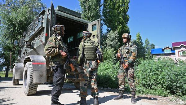 Indian army soldiers stands near the site of a gun battle between a suspected militant and Indian government forces in Kanipora area of Nowgam in central Kashmir's Budgam district on June 28, 2019 - Sputnik International