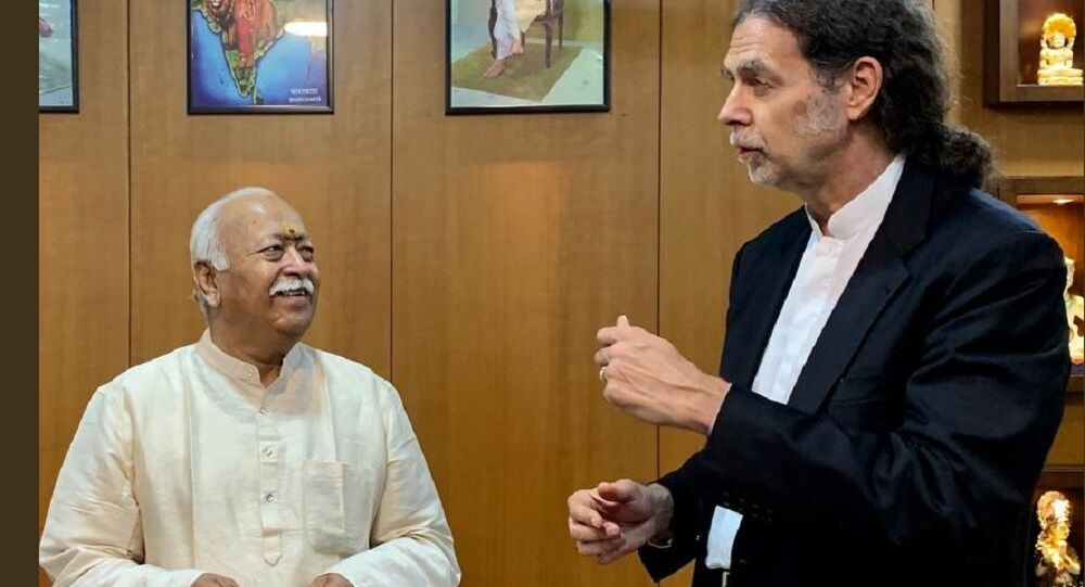 German Ambassador Walter J. Lindner (R) is pictured speaking with RSS leader Mohan Bhagwat (L)
