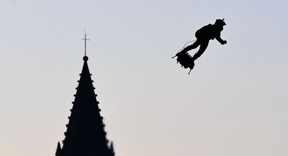 Zapata CEO Franky Zapata flies a jet-powered hoverboard or Flyboard over the old harbour as part of  Bastille Day celebrations in Marseille on July 14, 2019.