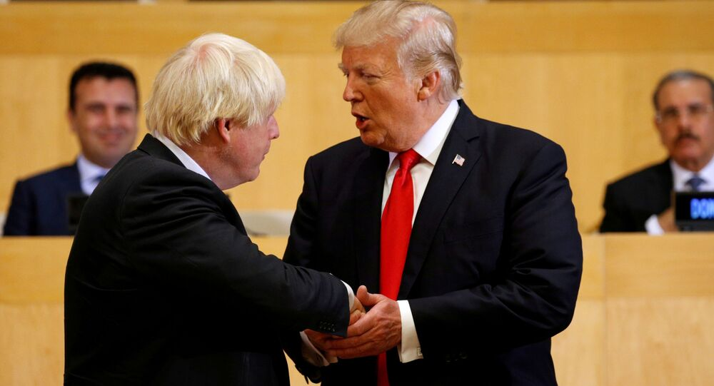 U.S. President Donald Trump shakes hands with British Foreign Secretary Boris Johnson as they take part in a session on reforming the United Nations at U.N. Headquarters in New York